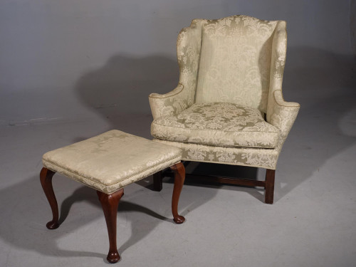 An Early 20th Century Mahogany Framed Wing Chair and Stool