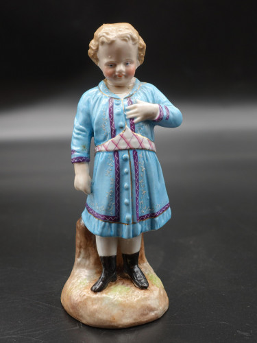 An Early 20th Century Porcelain Figure of a Young Girl
