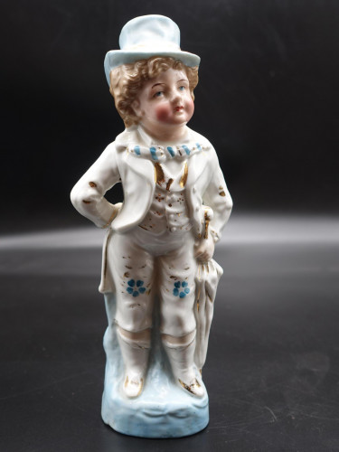 A Mid 20th Century Continental Porcelain Figure of a Child in a Top Hat.