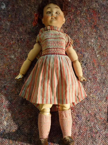An Early 20th Century Papier Mâché and Biscuit Porcelain Doll