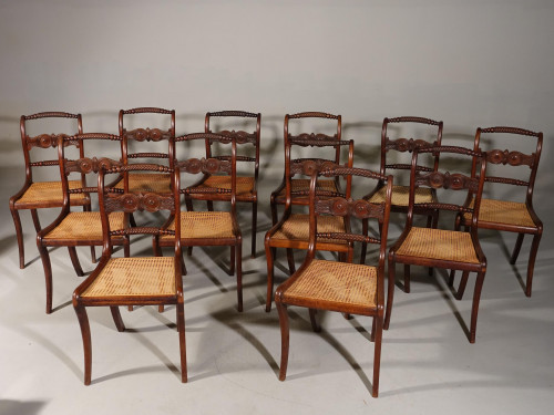 A Good Set of 12 Regency Period Mahogany Sabre Legged Dining Chairs