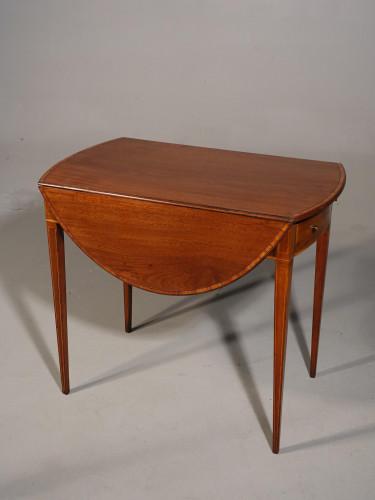 An Oval Shaped George III Period Mahogany Pembroke Table