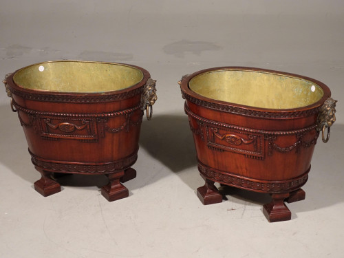 A Exceptional Pair of Oval Mahogany Cisterns