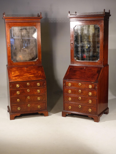 A Pair of Slender Mahogany Bureau Cabinets in the Manner of Thomas Chippendale.