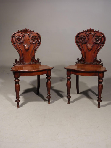 A Mid 19th Century Pair of Well Carved Mahogany Hall Chairs