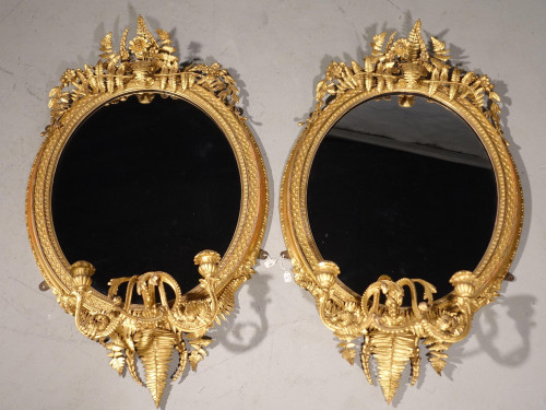 A Fine Quality Pair of Mid 19th Century Oval Giltwood Mirrors