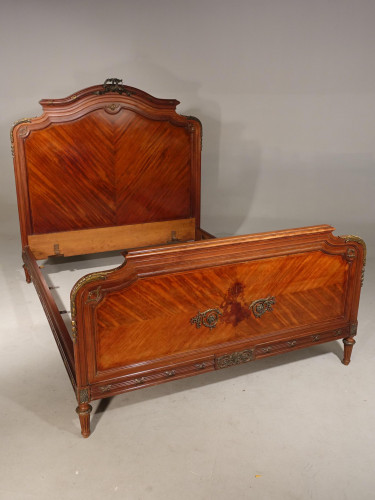 A Highly Figured Early 20th Century Double Bed