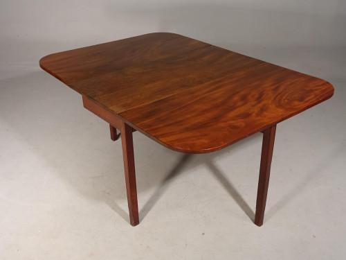 A Shaped George III Period Mahogany Drop-Leaf Table