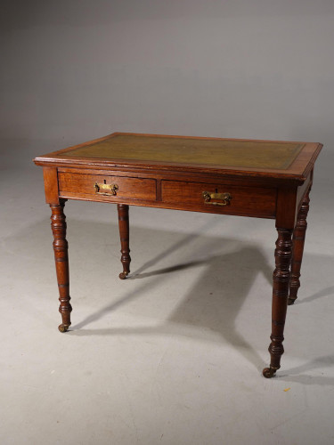 A Mid Victorian Oak Two Drawer Writing Table