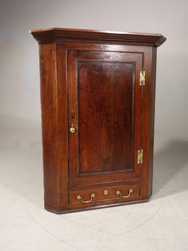 A Late 18th Century Panelled Hanging Corner Cupboard